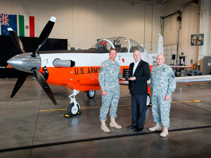 Pictured left to right: COL Steve Clark, U.S. Army Fixed Wing Project Manager, Dan Grace, Vice President, Business Development, Defense Company and COL Patrick Mason, Commander, RTC